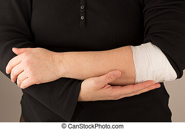 bandaged arm - Bodypart showing arms - holding a bandaged...
