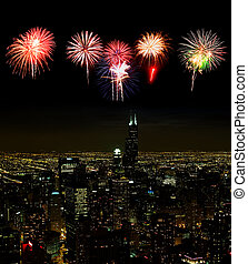 Aerial view of Chicago cityscape at night - with firework...