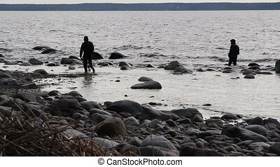 Two fishermen catching some fish on the sea - Two fishermen...