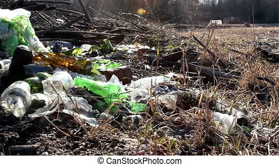 A part of the forest where there are garbage like broken...