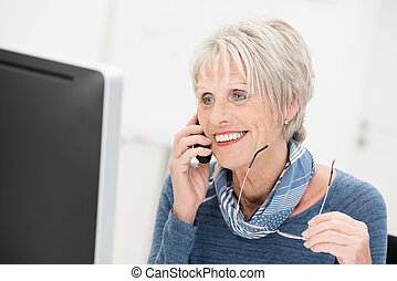 Attractive businesswoman chatting on the phone - Attractive...