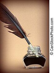 Quill pen in ink bottle
