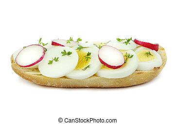 Sliced egg and radish, close up image