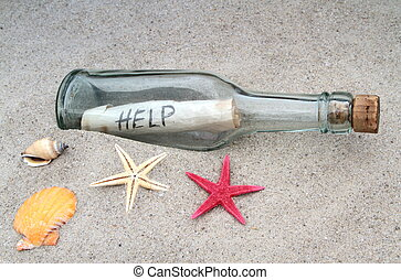 Message in a glass bottle on beach sand close up image