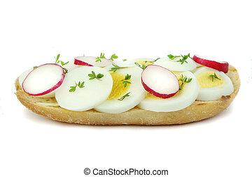 Sliced egg and radish close up image