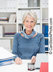 Senior manageress sitting in her office - Attractive stylish...