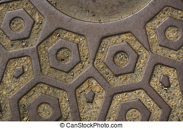 Geometric Manhole Cover - Closeup of manhole cover with...
