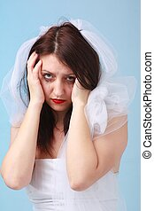 depressed young bride with running make up