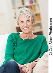 Confident relaxed beautiful senior woman