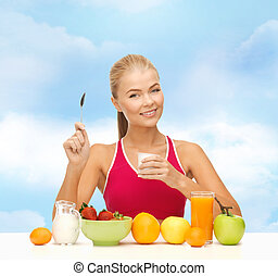 young woman eating healthy breakfast - fitness, healthcare...