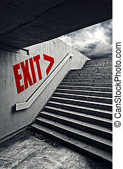 EXIT on Urban staircase in underground passage