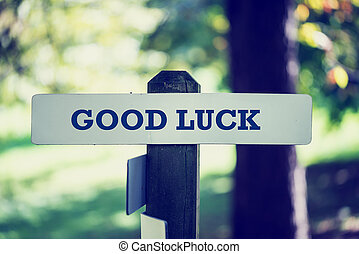 Good luck - Old rustic signpost with the phrase Good luck,...