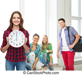young woman in casual clothes with wall clock - happiness...