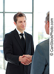 Two Business Man shaking hands - Business people shaking...