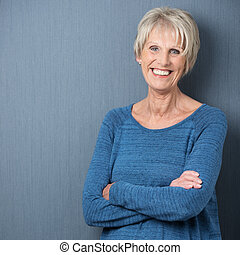 Happy confident attractive senior woman with blue eyes and a...