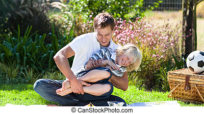 Father and son enjoying a picnic - Young father and small...