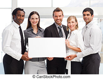 Business team holding a blank card in front of the camera
