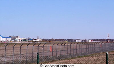 The view of the airports runway where airplanes take off and...