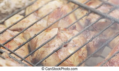 Cooking chicken on grill - Macro Meat chicken thighs on...