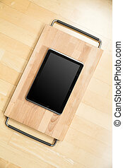 Tablet PC on a cutting board - A Tablet PC on a cutting...