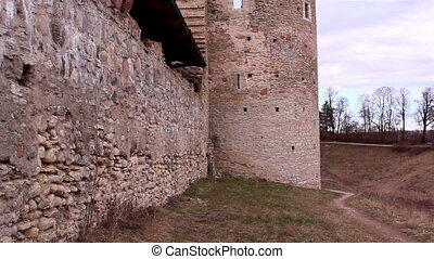The stone wall of the castle tower