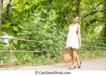 Young Girl walking in the park - A young Girl walking in the...