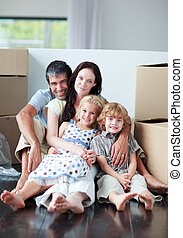 Family lying on floor after buying house - Happy family...