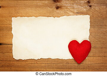 Blank Valentines card with felt hearton wooden background