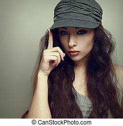Sexy girl posing in modern grey cap. Vintage portrait