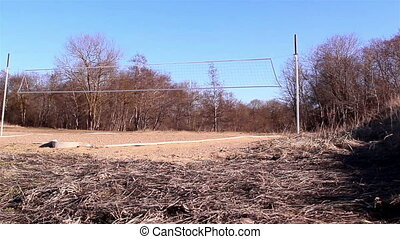 A volleyball net on a court