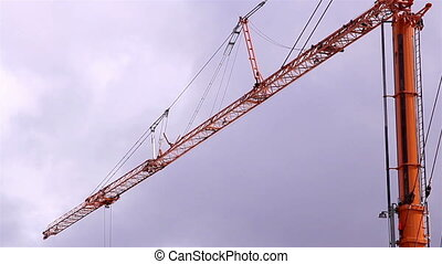 The metal huge crane with some wires and pulleys for...