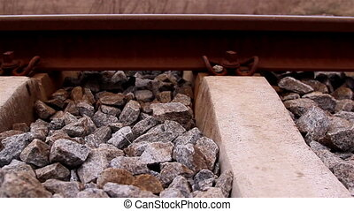 Lots of stones on the railroad for travelling trains