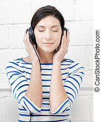 happy teenage girl in big headphones - technology and music...