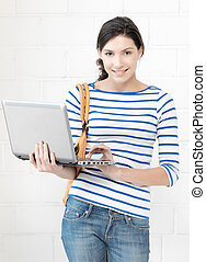 happy teenage girl with laptop computer - education and...