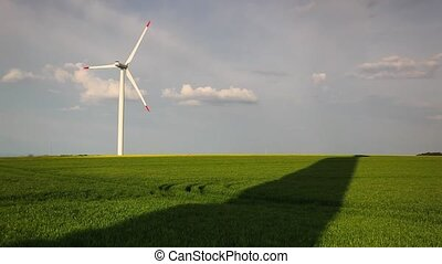 Wind farm on a spring field - Rotating wind farm and shadows...