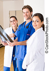 Medical doctors - group of young doctors in hospital ward...