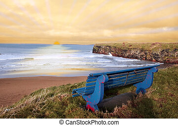 blue bench sunset view - ballybunion bench in winter with...