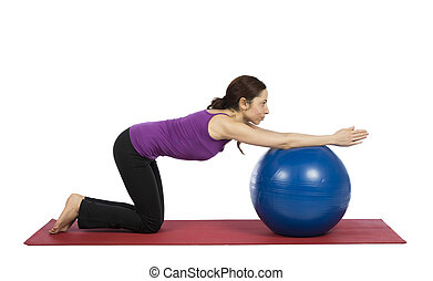 Woman working out her arms with a pilates ball - Young woman...