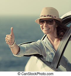 Woman driver in the car Summer vacation concept