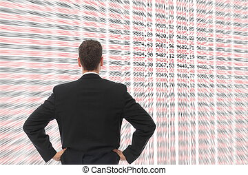Man in front of a big screen with numbers - A Man in front...