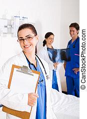 Medical doctors - 3 medical doctors in hospital ward