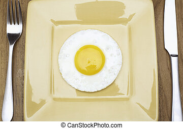 Fried egg on plate (directly above)