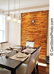 Modern dining room with wood panel