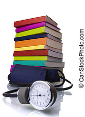 Learn medicine - medical equipment and a stack of books...