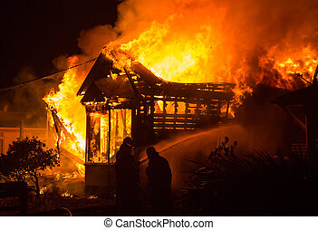 Hosue Fire - Old house well a blaze as fire men start to put...