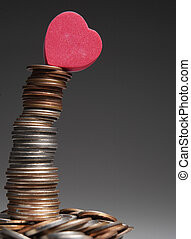 Stack of Coins with Love Heart on Top