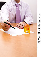 New house contract - businessman selling a new house at his...