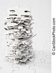 Stack of White Jigsaw Pieces
