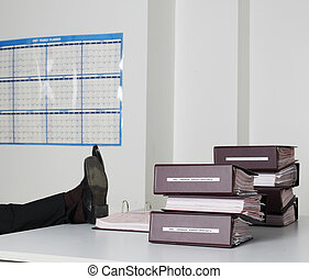 Office Workers Legs on Desk