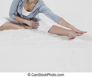 Mid-Adult Woman Stretching
